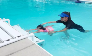 Rosie learning to swim