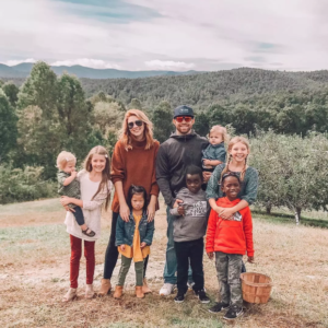 Rosie with her 6 siblings and mom and dad in beautiful photo in the countryside