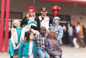 Rosie's family in China, with Chinese lanterns in background