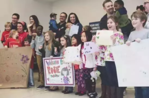 relatives and family friends welcome Rosie at the airport from China