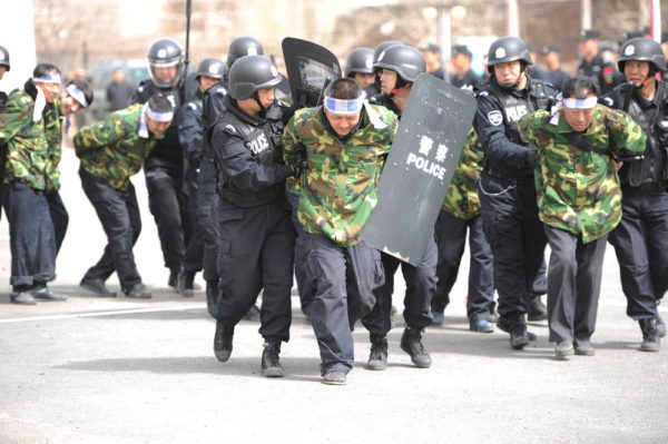 Chinese police shot dead dozens of knife-wielding attackers on Monday (28 July 2014) morning after they staged assaults on two towns in the western region of Xinjiang, the official Xinhua news agency said on Tuesday. A gang armed with knives had first attacked a police station and government offices in the town of Elixku, in Shache county, it said, quoting local police. Some moved on to the nearby town of Huangdi, attacking civilians and smashing and setting fire to six vehicles. An initial investigation showed that it was an organized and premeditated terrorist attack, Xinhua said. The dead and injured include not just Uighurs but members of Chinas majority Han Chinese population, the report said. The attack took place at the end of the holy month of Ramadan in Shache, also known by its Uighur name of Yarkant, located in Xinjiangs heavily Uighur southwestern part, close to the borders of Tajikistan, Pakistan and Afghanistan.