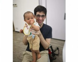 Joe holding baby Jacob at Little Life meeting